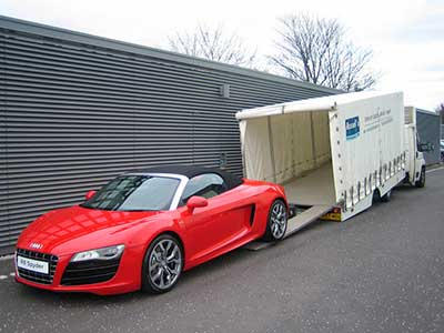 Audi loading into a covered car transporter