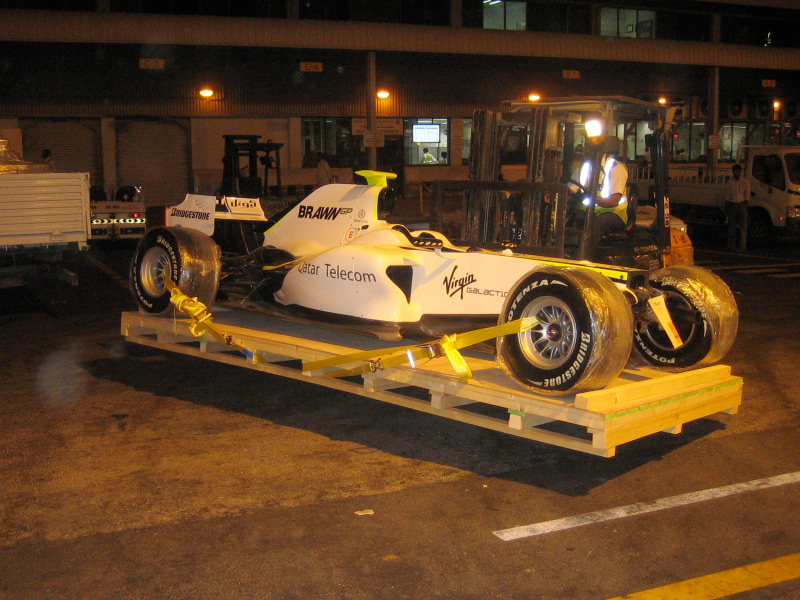 Brawn GP F Show Car To Doha Qatar And Russells Transport Covered - F1 show car